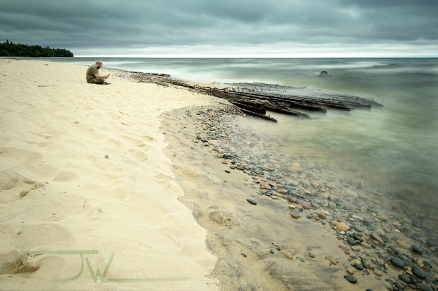 Sitting next to a shipwreck on the Shore of Lake Superior.